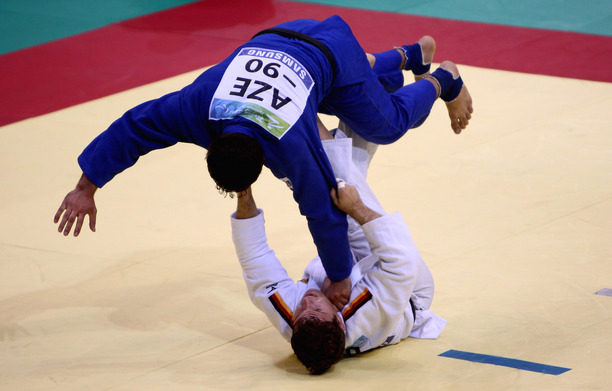 BEIJING - SEPTEMBER 09: Sebastian Junk of Germany (White) competes in the Judo -90kg match against Tofig Mammadova of AZE at the Beijing Workers' Gymnasium during day 3 of the Paralympic games on September 9, 2008 in Bejing, China (Photo by Jamie McDonald/Getty Images)